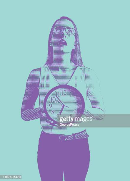 Young woman holding clock frustrated with deadlines