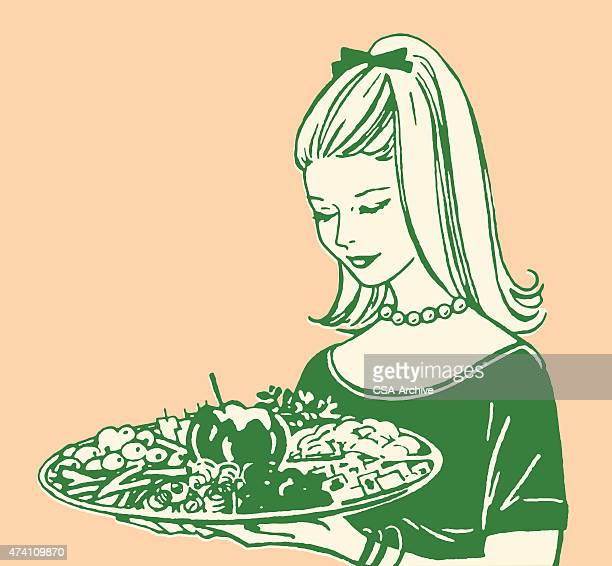 Young Woman Holding Veggie Tray