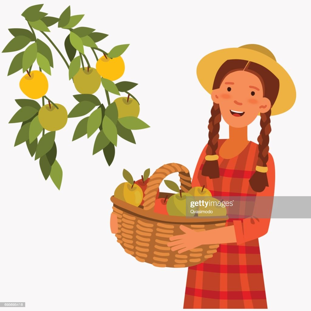 Young woman in a garden, holding a basket of apples