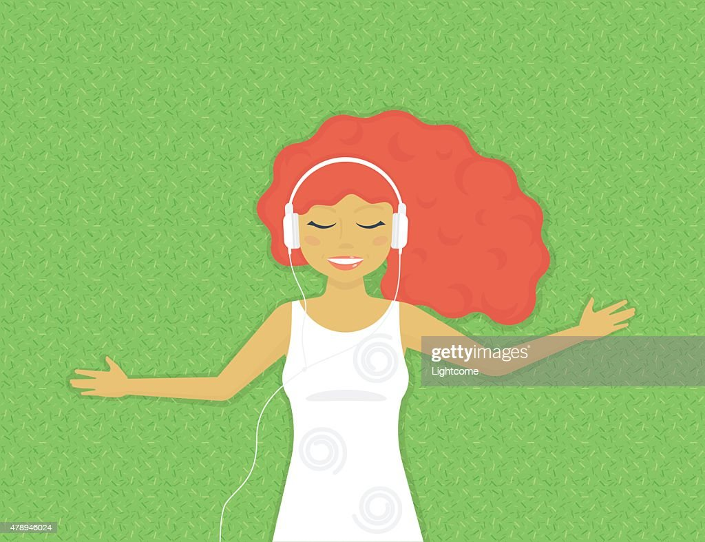 Young woman is listening to music