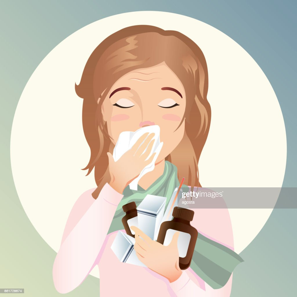 Young woman is sick. She has a runny nose and cough and holds the medicine in her hands.