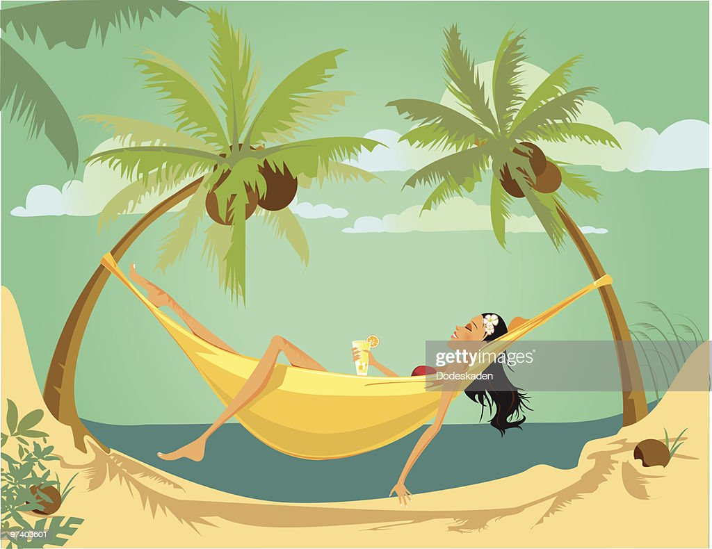 Young Woman Lying Down in Hammock Between Two Palm Trees