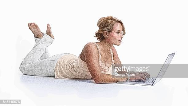 Young woman lying on floor using laptop and surfing the net