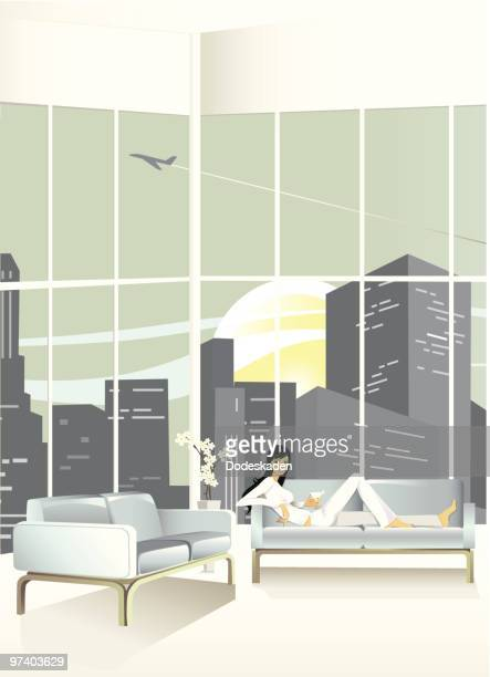young woman relaxing on couch in loft apartment - loft apartment stock illustrations, clip art, cartoons, & icons