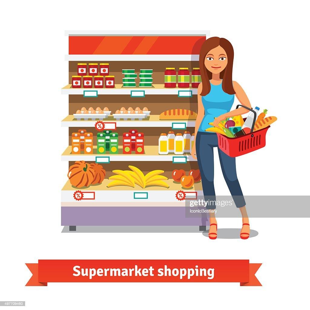 Young woman standing near supermarket shelves