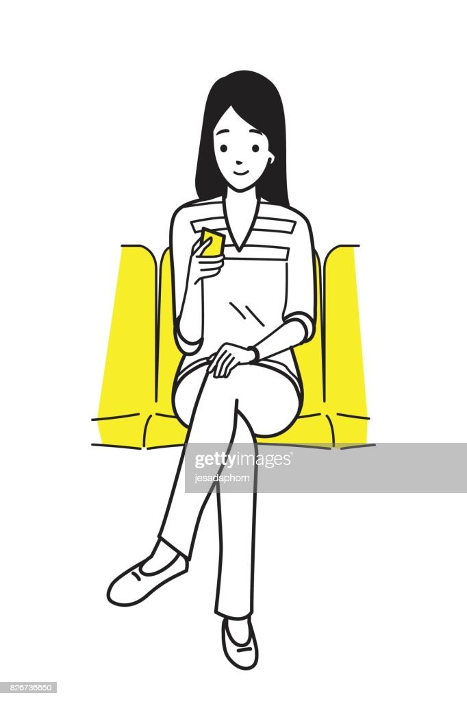 Young woman using smartphone in subway