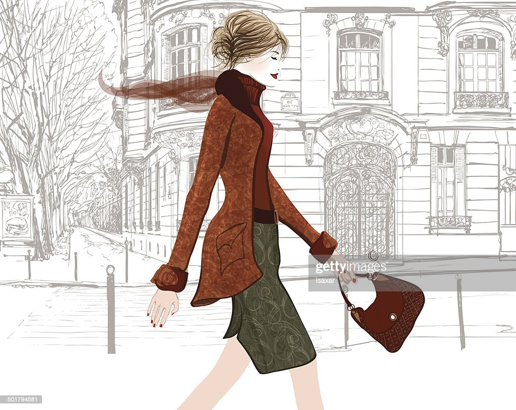 Young woman walking in a street of Paris