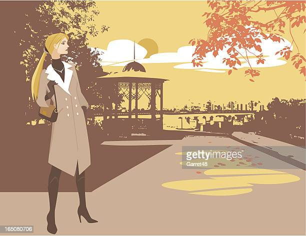 Young Woman Wearing Coat in Park During Autumn