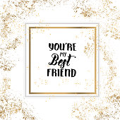 You're my Best Friend - Friendship Day lettering calligraphy phrase on golden and white background with golden tinsel. Hand drawn quote