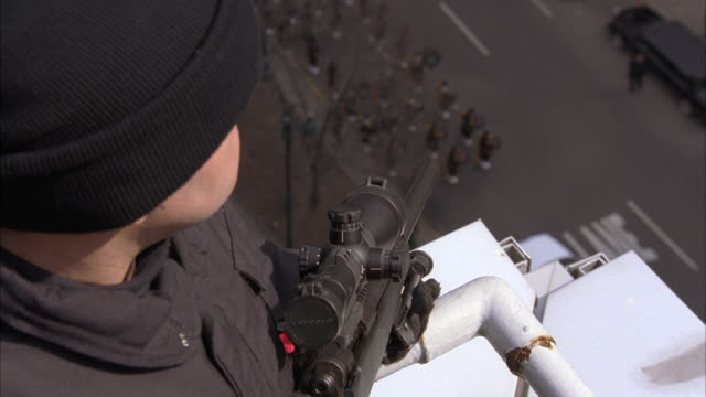 high angle down of military or police funeral in new york. soldiers or men in uniforms. american and irish flag outside of st. bartholomews church. park avenue. snipers or secret service officers with rifles on rooftop. - weapon stock videos & royalty-free footage