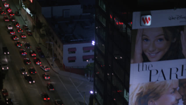 aerial of sunset boulevard, sunset strip. cars driving on city streets. billboards and advertisements. west hollywood. high rise office buildings and hotels. - sunset boulevard stock-videos und b-roll-filmmaterial