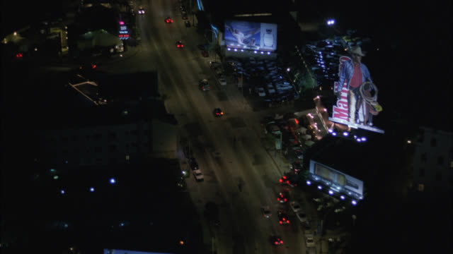 aerial of sunset boulevard, sunset strip. cars driving on city streets. billboards and advertisements. west hollywood. - sunset boulevard los angeles stock videos & royalty-free footage