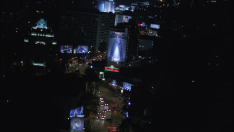 aerial of sunset boulevard, sunset strip. cars driving on city streets. billboards and advertisements. west hollywood. high rise office buildings and hotels. argyle hotel. - sunset boulevard los angeles stock videos & royalty-free footage