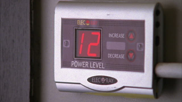 "close angle of digital gauge or meter reading ""elecray"" and ""power level"" with display numbers rising from one to twelve repeatedly. could control steam room, hot tub, tanning bed, laser or other appliance. - gauge stock videos & royalty-free footage"