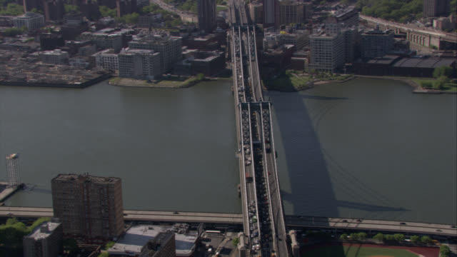 aerial of manhattan bridge, brooklyn. east river. cars driving on freeway or highway. cars on lower level of bridge stopped in traffic. - river east stock videos & royalty-free footage