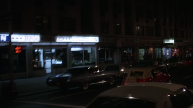 """PROCESS PLATE 3/4 LEFT FORWARD OF NEW YORK STREETS, TAXIS, PEDESTRIANS. THEATER MARQUEES FOR MOVIES """"CLASH OF THE TITANS, FOR YOUR EYES ONLY"""". DINER.PREVIEW FILE HAS BEEN TRIMMED FROM MASTER CLIP 6028-008. FOR ADDITIONAL FOOTAGE, SEE CLIP 6028-901. FULL C"""