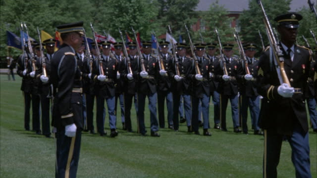 wide angle of marine marching band, marines marching in formation with rifles, flags, walking on grass field. could be military graduation ceremony. third unit dressed in colonial / revolutionary war uniforms with tri-corner hats.preview file has been tri - marines stock videos & royalty-free footage