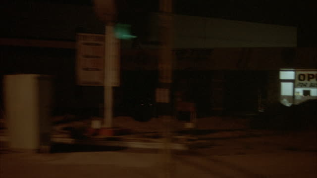 3/4 back process plate of town street. see shops and houses, reflection of street lights on windows. very dark shot. - huntington beach california stock videos and b-roll footage