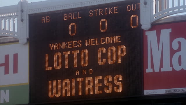 "close angle of led scoreboard at yankee stadium that reads ""yankees welcome lotto cop and waitress."" insert. - スコアボード点の映像素材/bロール"