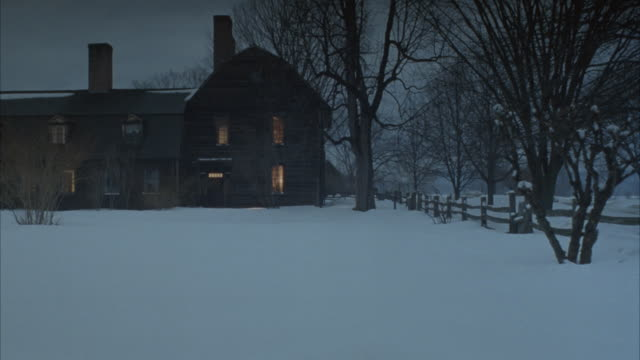 pan left to right of small town, pans from two story wood house to road with wood fence and three story brick house, horse drawn carriage moves from background to foreground right. snow on ground, winter. - brick house stock videos and b-roll footage