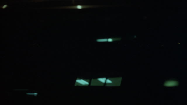 process plate of cars driving on freeway through urban area. see buildings in background. pov is from driver's side. extremely dark. - insel long island stock-videos und b-roll-filmmaterial