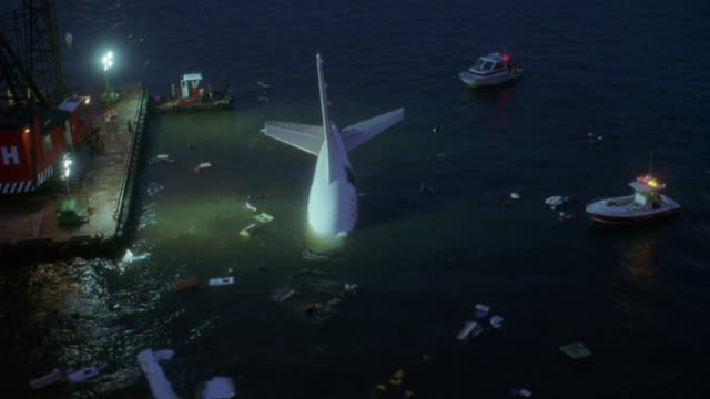 """aerial of commercial airliner submerged in bay. see only tail end out of water and see pieces of exterior of plane floating on surface. see coast guards and several boats surrounding plane. pov continues to circle around plane. see """"fox 5"""" helicopter and - airplane tail stock videos and b-roll footage"""