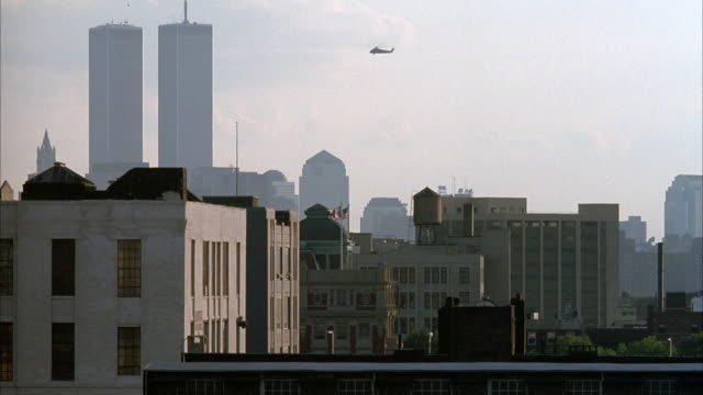 wide angle of new york city skyline in financial district in lower manhattan with small high rise buildings in foreground. see world trade center twin towers on left. - anno 1994 video stock e b–roll