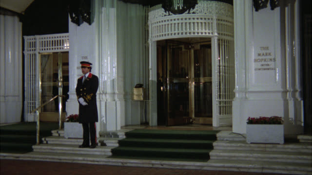 "wide angle of entrance and revolving doors of mark hopkins hotel. doorman. man exits. upper class. nob hill.<p><a href=""https://www.sonypicturesstockfootage.com/footage?kid=4332"">for day-night matching shots, click here.</a><p> - nob hill stock videos & royalty-free footage"