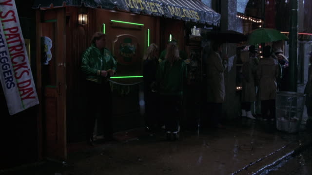 "medium angle of rain falling on nightclub or bar. see ""mother malones"" sign on awning. see ""st. patrick's day"" sign hanging at angle at frame left. - st. patrick's day stock videos & royalty-free footage"