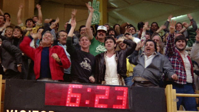 pan up from basketball scoreboard to spectators at a boston celtics game. see fans burst into applause and stand up. - scoreboard stock videos & royalty-free footage
