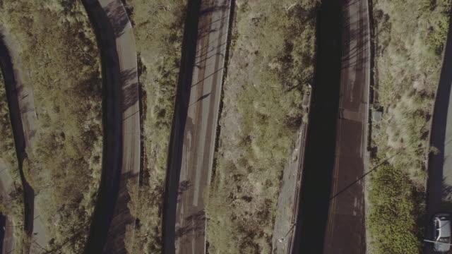 brazil - búzios - aerial view of curvy road - asphalt stock-videos und b-roll-filmmaterial