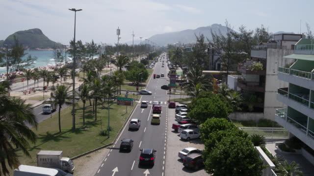 brazil - rio de janeiro - aerial view recreio dos bandeirantes beachfront - brasilien stock-videos und b-roll-filmmaterial