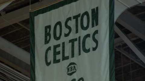 """pull back of """"boston celtics world championship"""" banners hanging in rafters at boston gardens. see lights and girders on ceiling. see banners for 1974, 1969, and 1968. - boston massachusetts stock videos & royalty-free footage"""