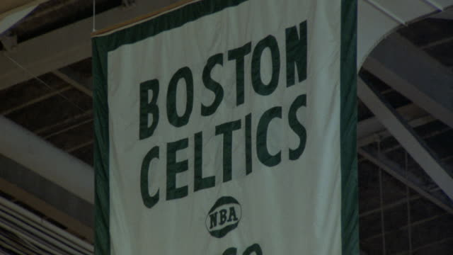 "pull back of ""boston celtics world championship"" banners hanging in rafters at boston gardens. see lights and girders on ceiling. see banners for 1974, 1969, and 1968. - boston massachusetts stock videos & royalty-free footage"