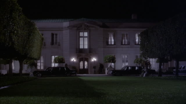 medium angle establish of older two story upper class house. 750 bel air road. french neoclassical style mansion. - french doors stock videos and b-roll footage