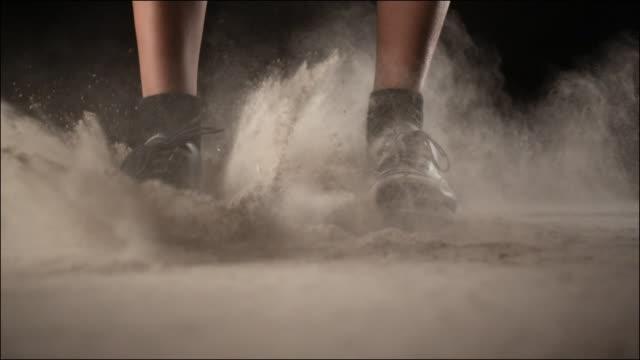 vidéos et rushes de close up feet tap dancing on the ground - représentation artistique