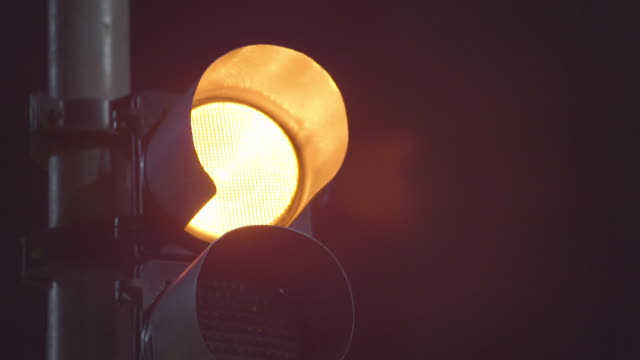 extreme close up -  traffic light changing from yellow to green - urban road stock videos & royalty-free footage