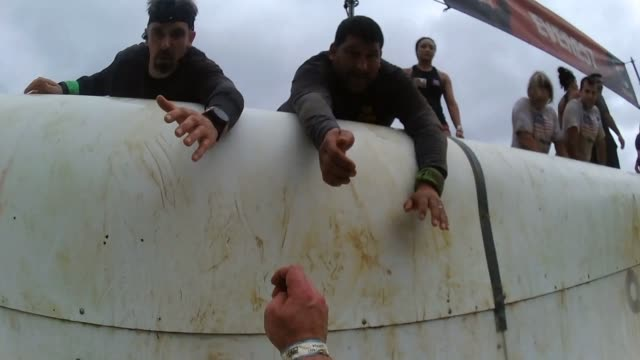 pov obstacle racer up steep ramp - tough mudder stock videos and b-roll footage