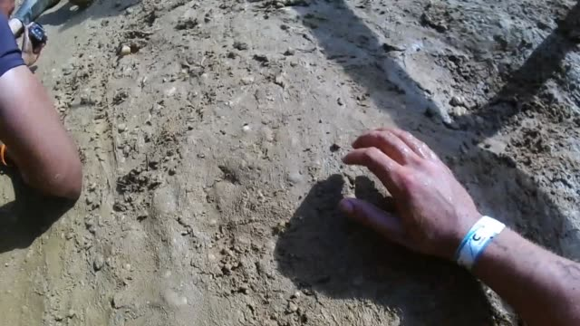 pov obstacle racer crawls through mud pit - tough mudder stock videos and b-roll footage