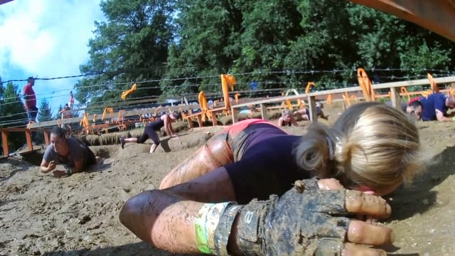 crawling through mud under barbed wire - salmini stock videos and b-roll footage