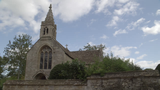 """wide angle of stone building, church or chapel at manor house in great chalfield, wiltshire, england. countryside or rural area.<p><a href=""""https://www.sonypicturesstockfootage.com/footage?kid=4338"""">for day-night matching shots, click here.</a><p> - https点の映像素材/bロール"""