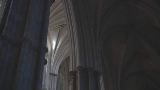 up angle of vaulted ceiling with gothic arches. stone building, could be cathedral or church. architecture. london, england. - westminster abbey stock videos & royalty-free footage