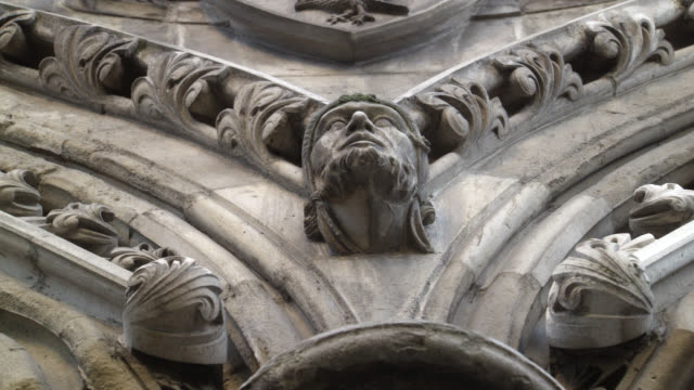 stockvideo's en b-roll-footage met up angle of statue, head, carving, or grotesque on stone building. could be church or cathedral. westminster abbey. architecture. - westminster abbey