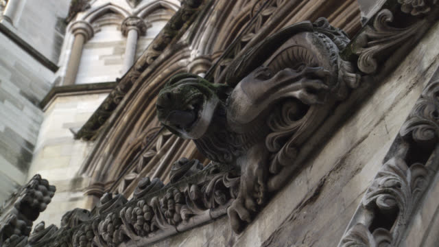 stockvideo's en b-roll-footage met up angle of westminster abbey, gothic church or cathedral. stone building. gothic arches with ornate decorations or carvings. gargoyles or grotesques. architecture. - westminster abbey