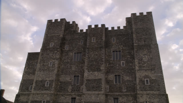 WIDE ANGLE OF MULTI-STORY STONE BUILDING OR CASTLE WITH CRENELLATION ALONG ROOF. COULD BE FORTRESS. DOVER CASTLE IN KENT.