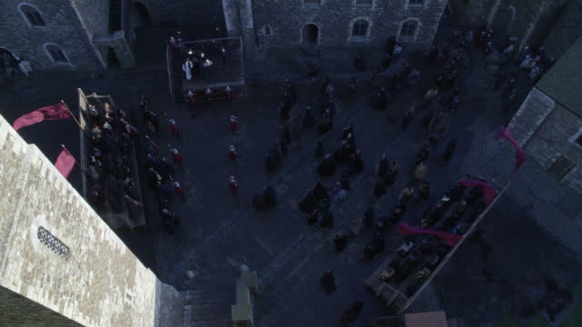 high angle down of renaissance public execution or beheading with crowd of townspeople or spectators. guards. could be tower of london. actually dover castle. stone buildings surround courtyard. death. - courtyard stock videos & royalty-free footage
