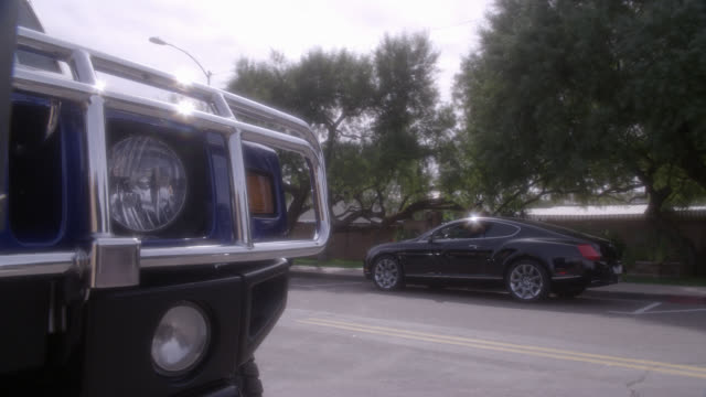pan right to left from headlight to radiator grille and logo of hummer suv or car. luxury cars, upper class. - hummer stock videos and b-roll footage