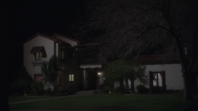 "WIDE ANGLE OF TWO STORY, UPPER CLASS SPANISH STYLE HOUSE, VILLA OR MANSIONWITH RED TILE ROOF AND STUCCO. LAWN AND TREE WITH BARE BRANCHES IN YARD.<P><A HREF=""HTTPS://WWW.SONYPICTURESSTOCKFOOTAGE.COM/FOOTAGE?KID=4285"">FOR DAY-NIGHT MATCHING SHOTS, CLICK HE"