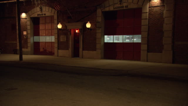 medium angle of fire station. brick building. - fire station stock videos & royalty-free footage