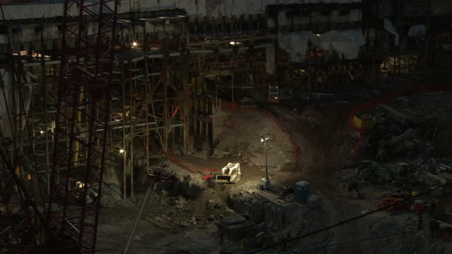 high angle down of ground zero. construction cranes. bulldozer and construction equipment. lower manhattan. - bulldozer stock videos and b-roll footage